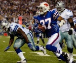 Buffalo Bills' George Wilson (37) returns an interception for a touchdown against the Dallas Cowboys during the first quarter of the NFL football game at Ralph Wilson Stadium in Orchard Park, N.Y., in this Oct. 8, 2007. On Monday night, Oct. 8, 2007.