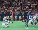 Buffalo Bills kicker Steve Christie (2) kicks a 34-yard field goal in overtime to beat the New York Giants 23-20 Sunday night, Sept. 1, 1996, at Giants Stadium in East Rutherford, N.J. Bills' Chris Mohr, left, is the holder and Giants' Phillippi Sparks (22) is at right.