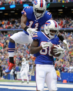 Marquise Goodwin,T.J. Graham