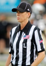 In this Sept. 3, 2011 photo, Conference USA official Sarah Thomas looks downfield before an NCAA college football game between Central Florida and Charleston Southern in  Orlando, Fla. Thomas is on track to become the NFL's first permanent female official, possibly as early as 2014, and is a finalist in the NFL's scouting program. (AP Photo/Reinhold Matay)